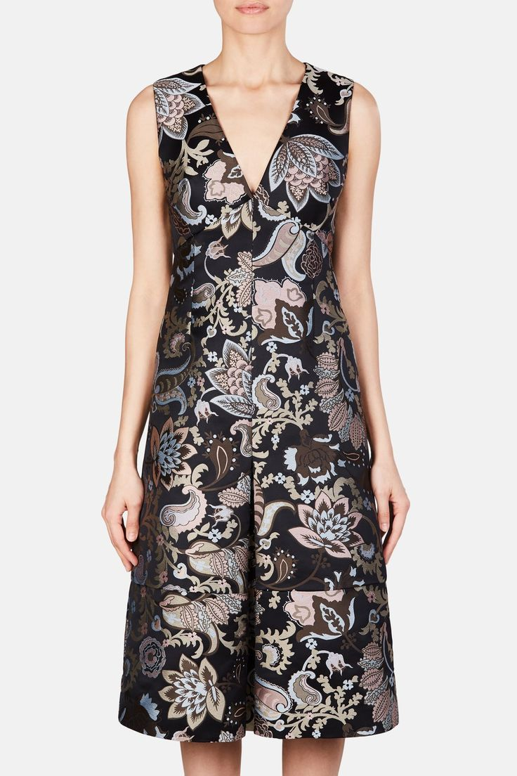 #ERDEM Black/Multi  Kamila Dress - Black/Multi   —$1,720 Description Erdem Moralioglu was inspired by both his home in London, England and his Turkish heritage when deigning the ERDEM Fall 2017 collection—think English florals, Ottoman miniatures and 18th century sultans. This elegant dress exudes 1940s glamour with a flattering and slightly structured silhouette cut from floral silk jacquard. Features include the V-neckline, paneled bodice, discreet inseam pockets, and a box-pleated skir