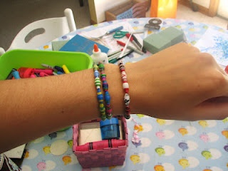 Homemade paper bead bracelets. Perfect craft for birthday party or just for fun!