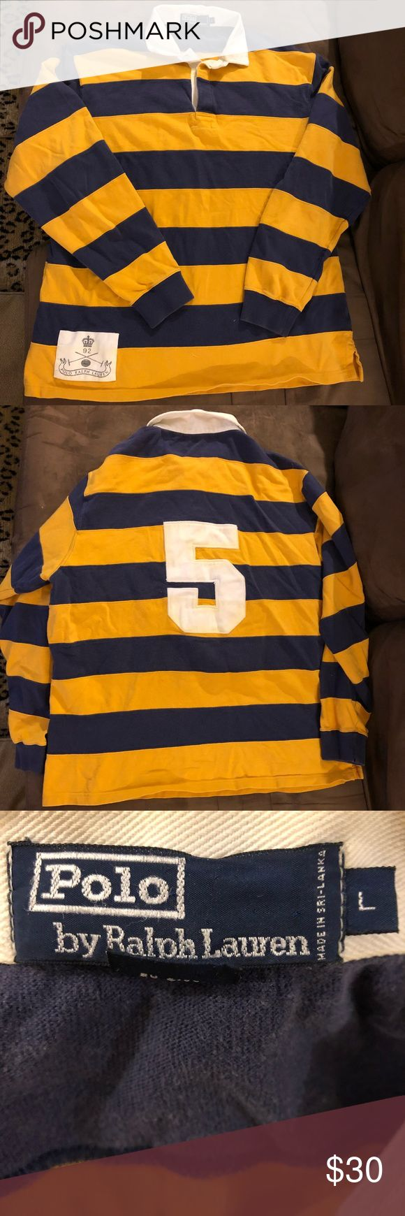 Polo Ralph Lauren Navy & Gold Stripe Rugby Shirt L Polo Ralph Lauren Navy Blue and Gold Stripe With White 5 Long Sleeve Rugby Shirt size L! Great condition! Please make reasonable offers and bundle! Ask questions! :) Polo by Ralph Lauren Shirts