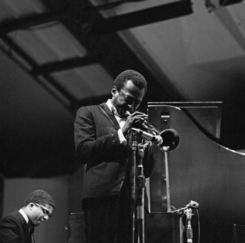 American jazz musician and composer Miles Davis (1926 - 1991) performing at the Newport Jazz Festival, Newport, Rhode Island, 2nd July 1967. On the left is pianist Herbie Hancock.