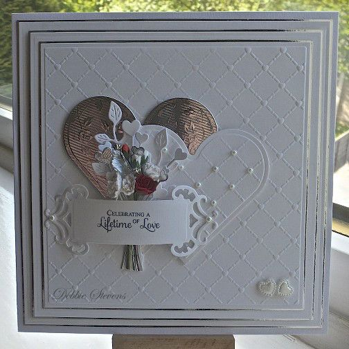 Todays card could be for Wedding or Anniversary as it is the season for weddings. Ive used Spellbinders grand squares for base layers, Spellbinders classic hearts, Spellbinders fancy tags two, Creative expressions heart lattice embossing folder, cheerylynn ivy leaf corner, heart stems by impression obsession, flowers from Wild orchid crafts, cardstock from Annamarie designs, sentiment stamp is from justrite ever after antiques label one.