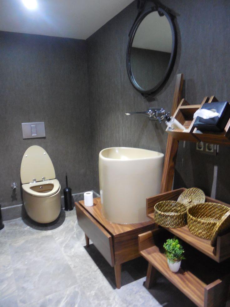 Cream coloured sanitary wear in minimalistic style bathroom