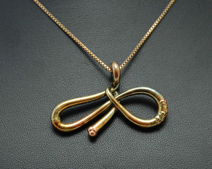 "Necklace with pendant in the shape of infinity ""melted"". Electroformed copper, gold plating iridescent."