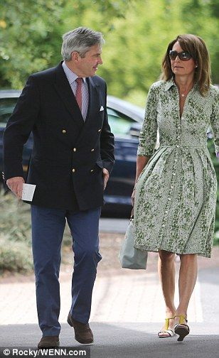 Making an entrance: Carole and Michael Middleton arrive to see the action at Wimbledon thi...