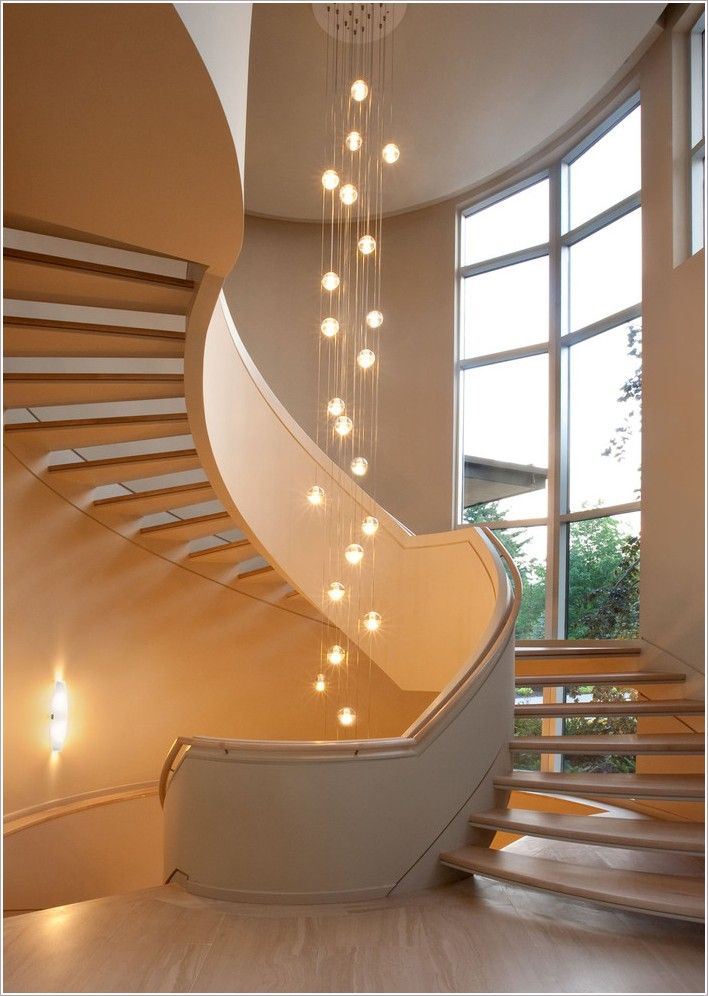 contemporary grand staircase with glass bubble chandelier