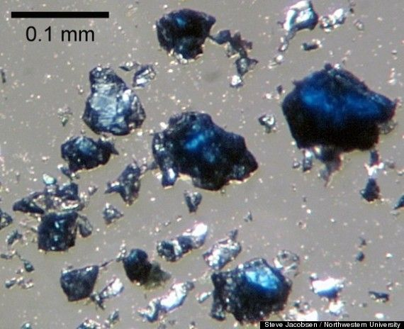 """We may have another """"ocean"""" to add to the world map -- only this one is hidden hundreds of miles beneath our planet's surface. A new study suggests that a hidden """"ocean"""" is nestled in the Earth's mantle some 400 miles beneath North America. The hidden reservoir, apparently locked in a blue crystalline mineral called ringwoodite, may hold three times as much water that exists in all the world's surface oceans."""