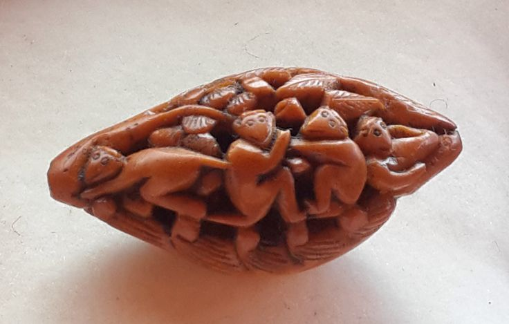 Chinese carved kernels..monkeys playing on a boat. JL Collection