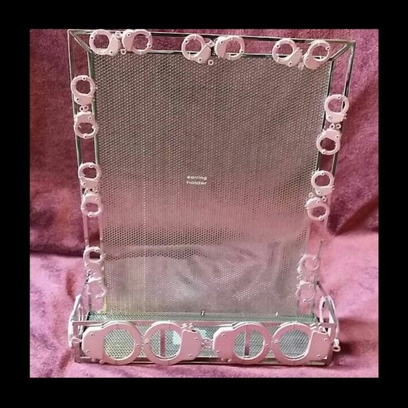 Unique and pink handcuffs jewelry holder Unique pink handcuffs jewelry holder for pierced earrings, bracelets, necklaces, watches etc. Jewelry
