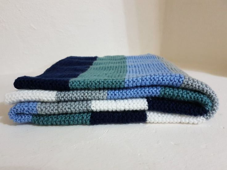 Homemade of course. Hrs of love into this baby boys stripped knitted blanket in shades of teal, grey navy, blue and white 😍😍😍 all ready for the new arrival 😁
