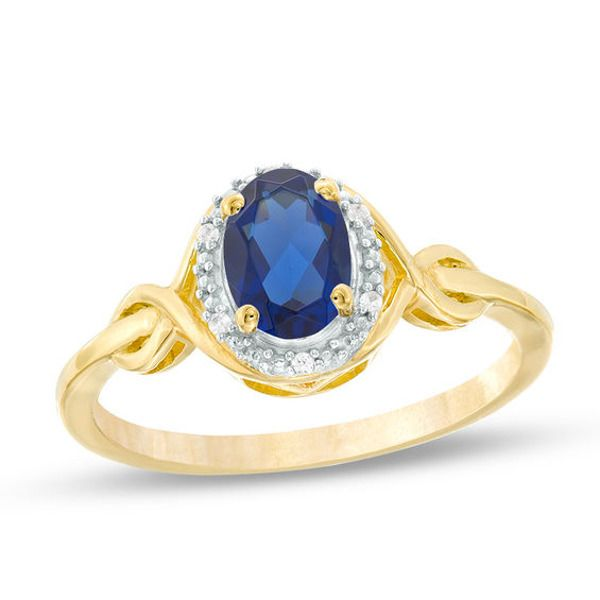 Oval Lab Created Blue Sapphire And Diamond Accent Twist Ring In 10k Gold In 2020 Twist Ring Blue Sapphire Diamond