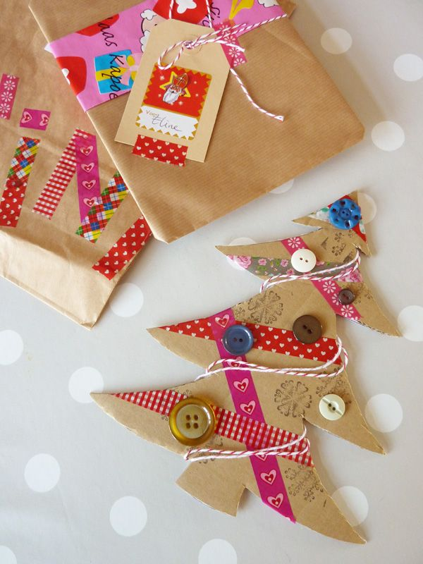 corrugated cardboard Christmas tree card with washi tape, buttons, rubber stamps and baker's twine.