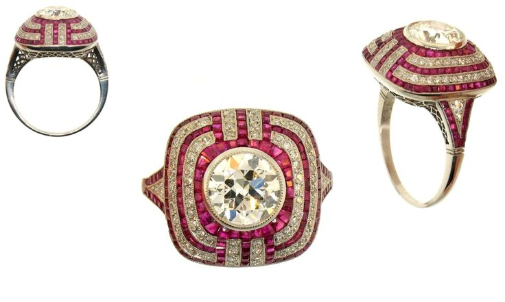 O o o o!  Ruby, diamond and platinum ring with 1 old European cut diamond weighing 1.50 carats, 64 round diamonds weighing 0.75 carats and numerous calibrated rubies in the Art Deco style.