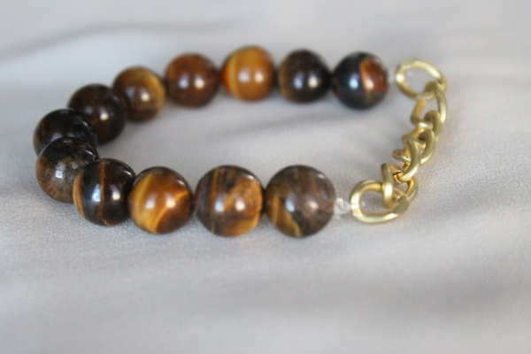 Brown beaded bracelet with large golden chain