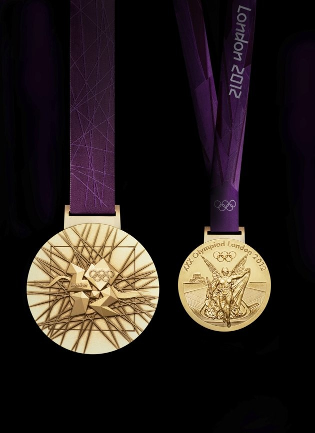 Close-ups of Olympic medals - In this image made available by the London Organising Committee of the Olympic Games on Wednesday July 27, 2011 shows London 2012 Olympic gold medal designed by British artist David Watkins. The front of the medal is on the right, all medals are 85mm in diameter. (AP Photo/LOCOG, HO).