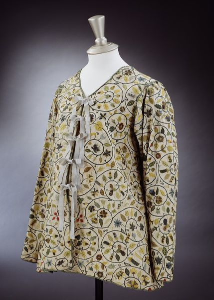 A woman's loose linen jacket (probably worn during pregnancy)  ca 1590-1630, English. Embroidered with silk, silver, and silver gilt threads in a circular vine motifs with flowers and fruit. The embroidery pattern is very similar to the famous extant Layton jacket (for which there is a 17th c. painting of Lady Layton wearing the actual garment) but this jacket made from a single layer of linen and there are no cuffs. The Layton jacket is better constructed and more fitted..