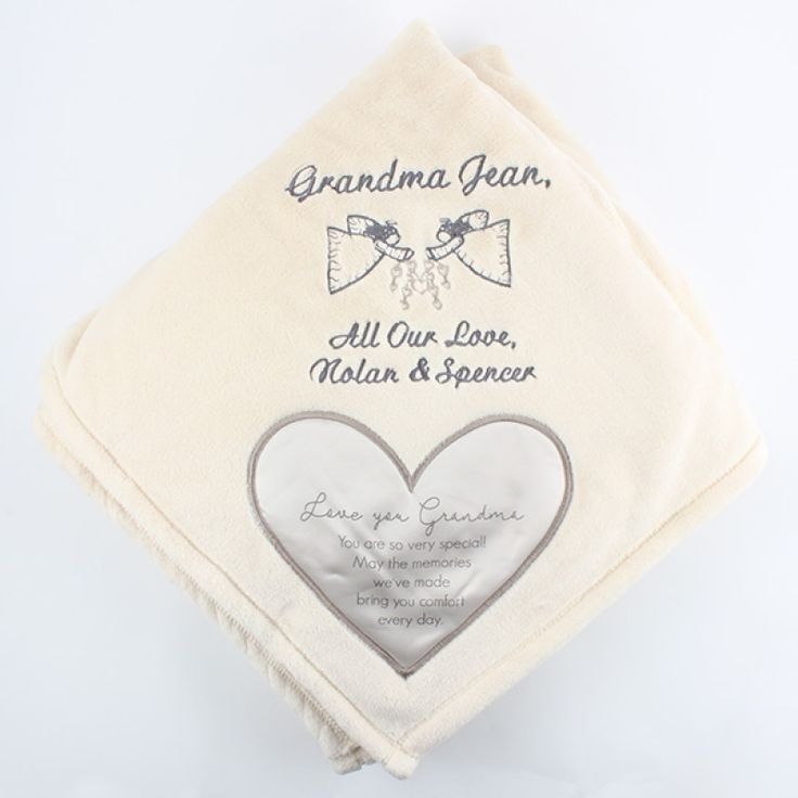 "Grandma Royal Plush Blanket  50x60 - This soft, thick blanket makes a lovely gift for a Grandma who is special to you. It comes with a satin heart applique in one corner that is full of comforting words. Our embroidery specialists can add a message and design above the heart to make it a treasured keepsake.  Message inside satin heart reads ""Love you Grandma. You are so very special! May the memories we've made bring you comfort every day."""