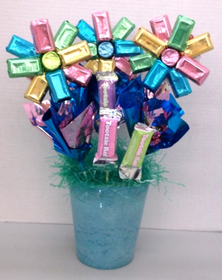 Candy Arrangement Designed by Fruth Pharmacy in Ripley, WV.  Hershey Miniatures make the flowers! Call 304-372-1605 if you would like to order this gift.