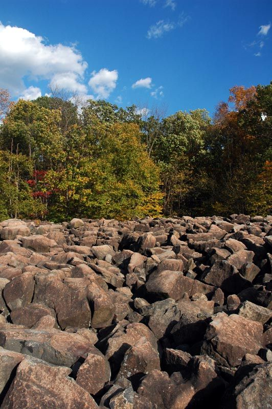 Ringing Rocks Park, Bucks County, Pennsylvania. This place is amazing. Rocks there sound like bells when struck with a hammer.