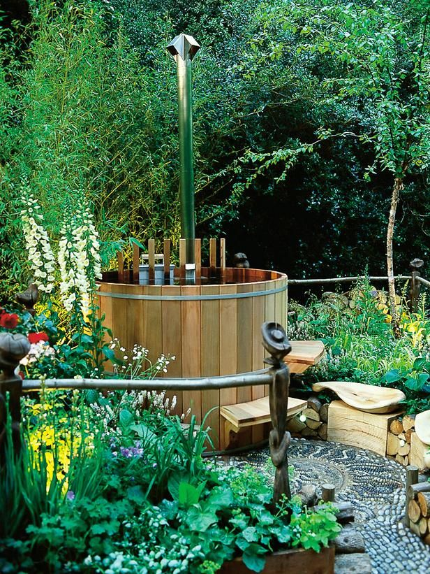 Hot Tub Fits Into Small Garden Design: Redwood timbers and wildflowers prove you can create a peaceful, secluded feeling even in a small garden.