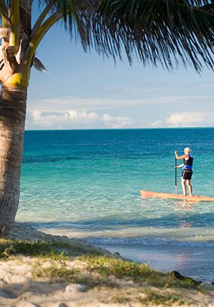 No fee resort activities Paddleboarding-off-Resort-Beach---Castaway-Island,-Fiji