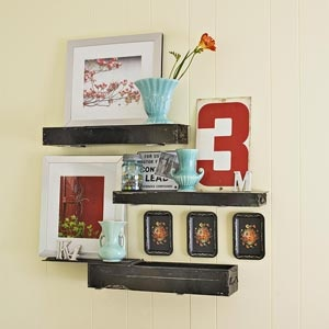 Safe Deposit Box Shelves -- magnetics hold them to wall brackets.  Very cool!  Now where can I get old safe deposit boxes??