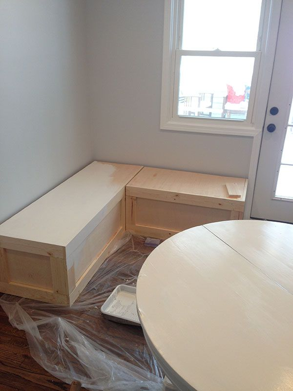 Looks pretty straightforward.  Ashley Ella Design: DIY Corner Bench for a Breakfast Nook