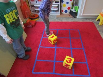 Math - Getting our whole bodies into the math process helps us to reinforce basic math skills as well. We toss the large die to tell us how many steps, hops, or squares we can go…