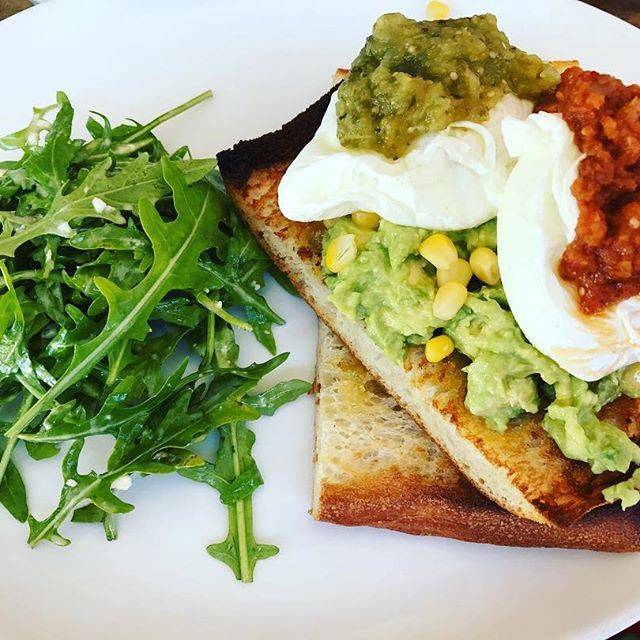 Smashed avocado, homemade spicy tomato salsa and perfectly poached eggs. Yum. The perfect way to start the day! #2delicious4words #breakfast #sydney
