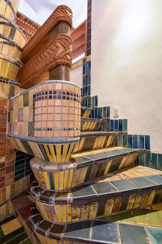 Once a live/work space for artists, the 3,500-square-foot residence is full of bespoke tile work, wood carvings, and stained glass.