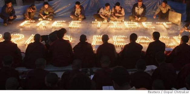 Tibetan nuns pray while others light butter lamps during a peaceful demonstration at Buddha Park in Kathmandu March 23, 2008. China accused the Dalai Lama on Sunday of using unrest in Tibet to back demands for Tibetan independence ahead of the August Olympic Games in Beijing. REUTERS/Gopal Chitrakar (NEPAL) Ran on: 03-24-2008 Tibetan monks pray while others light butter lamps during a peaceful demonstration at Buddha Park in Kathmandu, Nepal. Photo: GOPAL CHITRAKAR