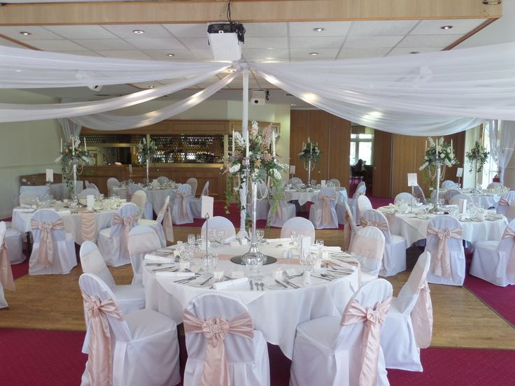 Bagden Hall - Orchard Suite - Wedding reception. Chair covers with blush taffeta sash & diamante buckle. Candelabras with floral dressing. www.uniqueweddingflowers.co.uk