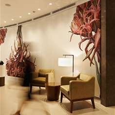 Design by Red Design Group-An interpretation of a Sydney artist's painting of the local Gymea Lily was commissioned upon discovery during design research and carried through to the exotic upholstered paneled wall and custom rug.