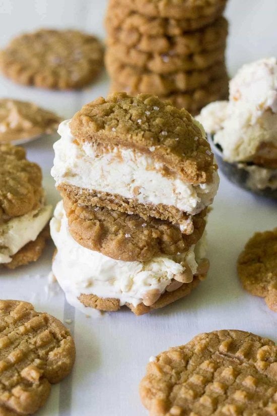 Calling all peanut butter lovers! These easy peanut butter cookie ice cream sandwiches are made with flourless peanut butter cookies and homemade peanut butter swirl ice cream. This is the ultimate summer dessert!