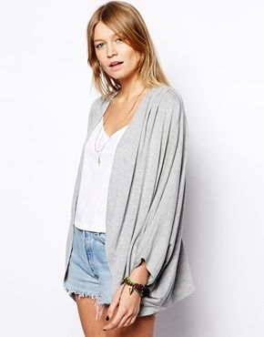 A kimono is a good way to cover up without the heat of a cardigan and is on trend right now.