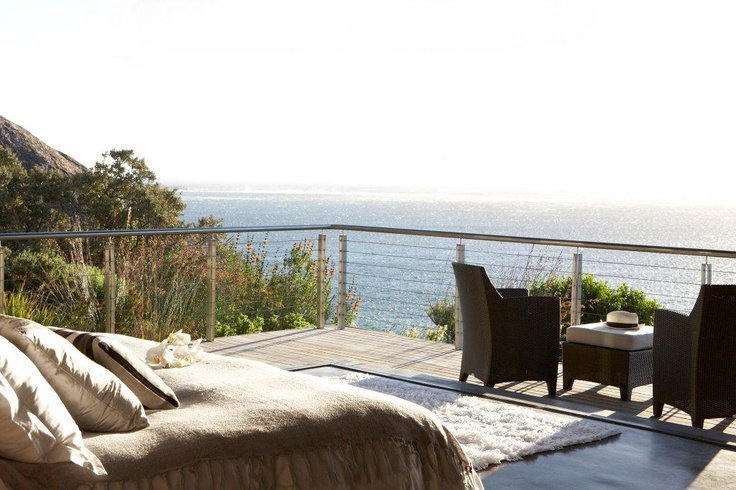Catch the morning sunshine on your private deck overlooking the ocean. 26 Sunset Avenue   Llandudno