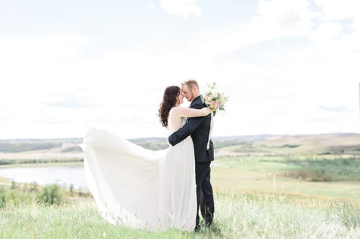 Wedding Photography - Kissing in the Meadow • blog • — Jamie Hyatt Photography | Calgary Wedding Photographer #weddingphotography #meadowkiss #photography #wedding #brideandgroom