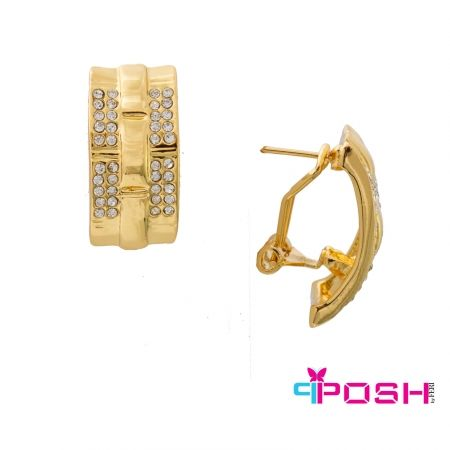 - Gold tone metal - Encrusted with clear stones - French backing - Dimensions: 3 cm x 1.5 cm
