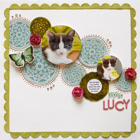 This is a scrapbook page but I can see a similar wall grouping with embroidery hoops, plates and family pictures...