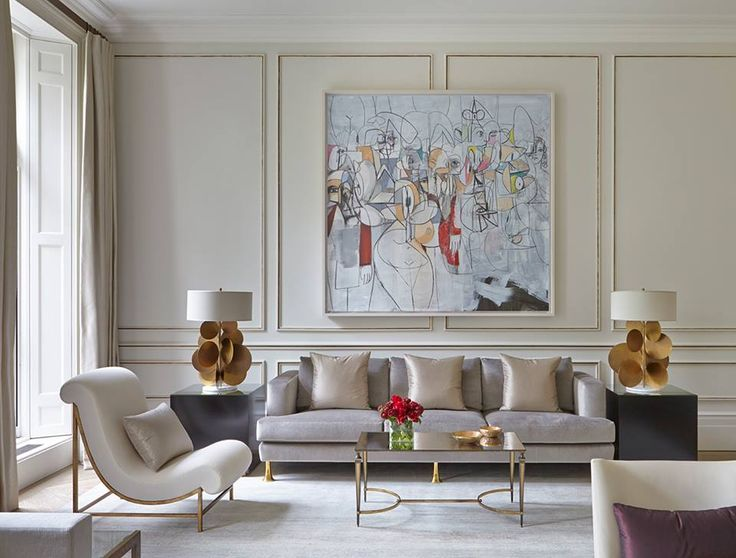 Living Room - Taking centre stage is a large abstract work of art with a soft gray palette background. #memoir #livingroom #sofa #residences #golddecor #boutique