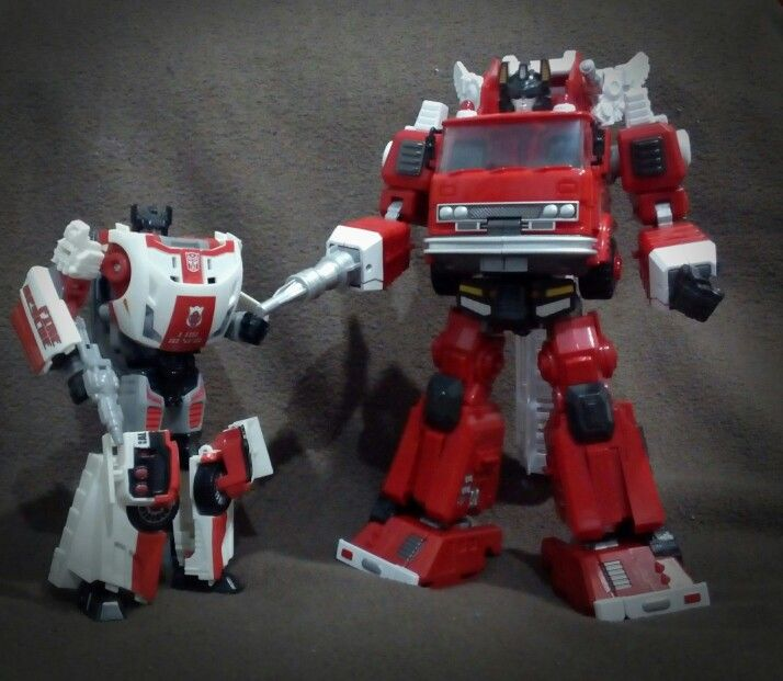 Hasbro Red Alert and Maketoys Hellfire (not) Inferno.