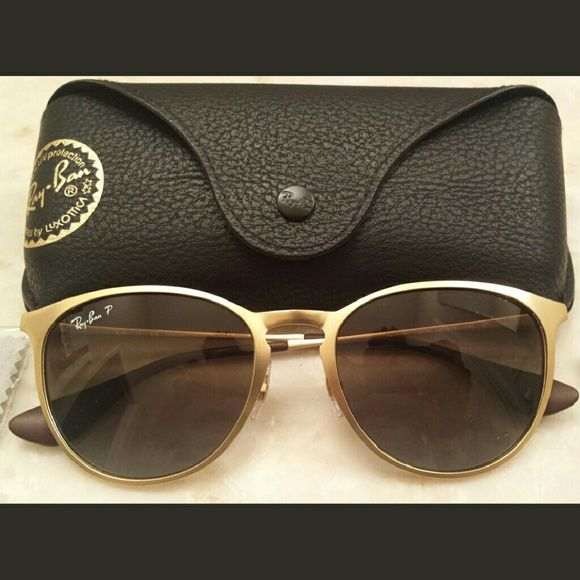 NWT Ray-Ban Erika matte gold sunglasses polorized BRAND NEW, NEVER WORN Ray-Ban Erika matte gold polorized sunglasses W/ CASE & CLOTH & BOOKLET  ***1000% AUTHENTIC!!! (Like all my items, so please don't ask)***  MSRP $170   A sleek, feather-light metal frame with a cool ombr? finish brings plenty of contemporary style to sunglasses fitted with gradient lenses and adjustable nose pads.  -54mm lens width; 19mm bridge width; 145mm temple length -POLORIZED!!!(anti-reflective) -100% UV protection…
