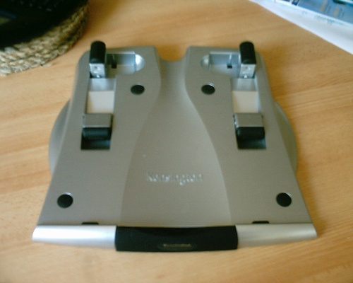 Kensington laptop riser. Laptops are expensive but very mobile and usefull...
