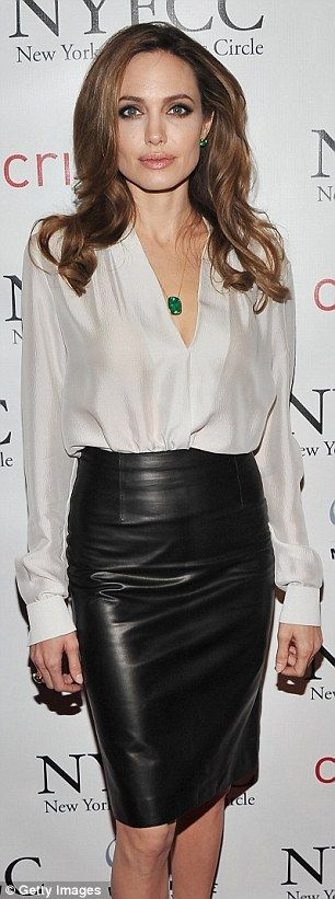 Perfection: The 36-year-old actress stuns in a leather skirt and emerald gemstones