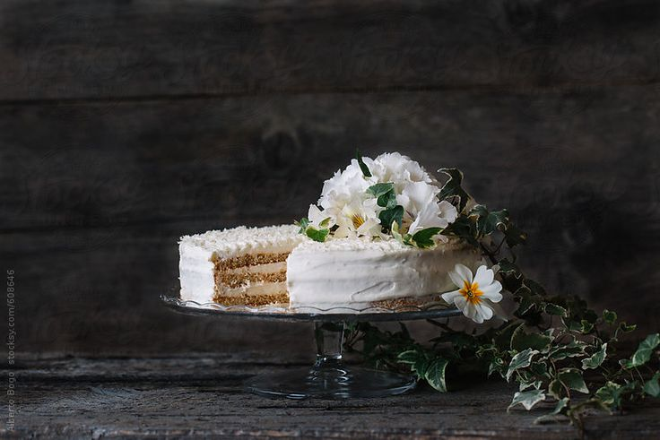 White chocolate cake with flower by albertobogo | Stocksy United #cake #flower #white #chocolate