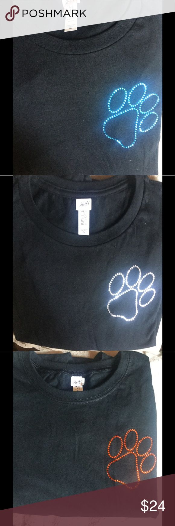Women's tees with large dog paw Black tees with large dog paw in teal, silver or tangerine.  Sizes Small thru 2X Bella Tops Tees - Long Sleeve