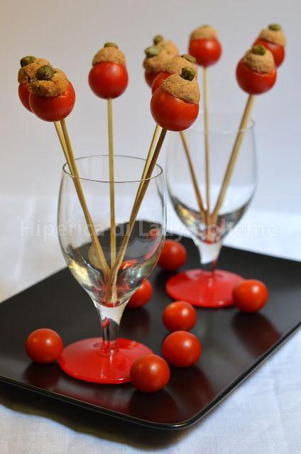 Finger food pomodorini ripieni (Finger food stuffed tomatoes)