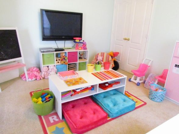 Love the idea of table and cushions in the center of the playroom. ...maybe they will color there instead of the living room floor!