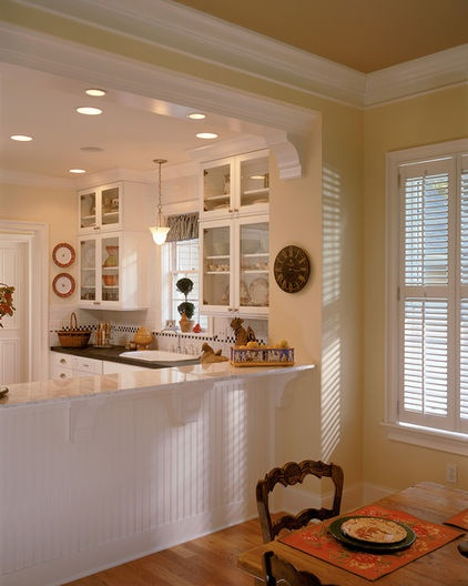 Molding on pass through wainscoting on kick wall Kitchen breakfast room designs