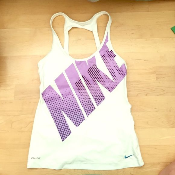 Nike tanktop White with purple lettering and blue/black pattern on the letters. Willing to negotiate! Buy in the next 24 hours, get a free gift! Nike Tops