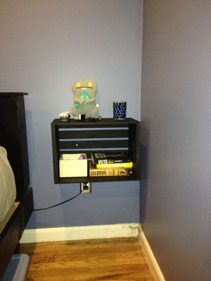 Painted wooden crates hung as floating night stands